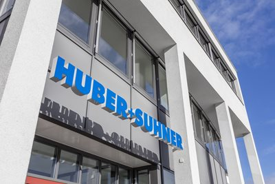 Logo HUBER+SUHNER on wall